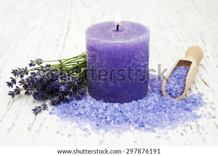 Lavender, candle and massage salt on a old wooden background - stock photo