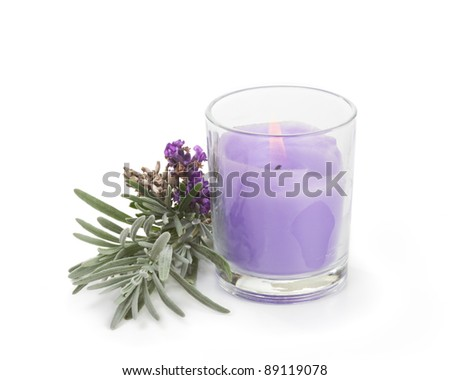 Lavender candle with fresh lavender on white - stock photo