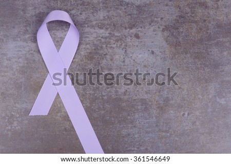 Lavender color ribbon, symbolizing awareness for all cancers. February 4th, world cancer day.  - stock photo