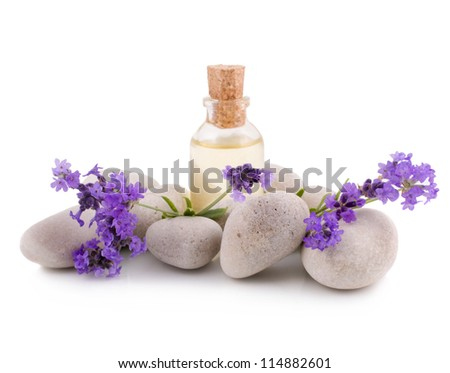 Lavender, essential oil and white stones isolated on a white background - stock photo