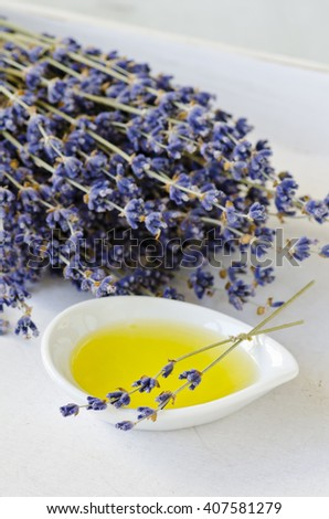 Lavender essential oil on a small bowl. Selective focus. Taken in daylight. - stock photo