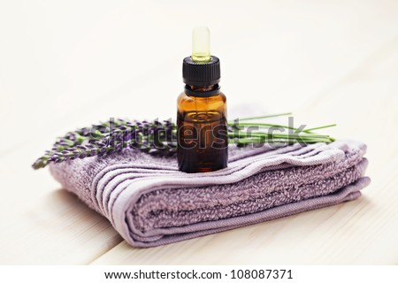 lavender essential oil with fresh flowers - beauty treatment - stock photo