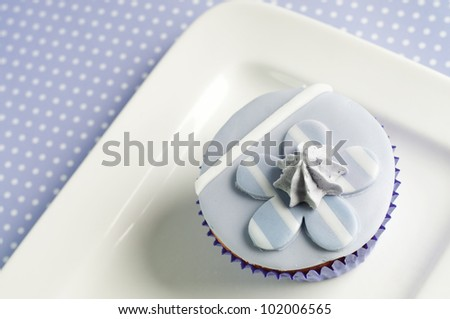 lavender flower blossom cupcake with stripes - stock photo