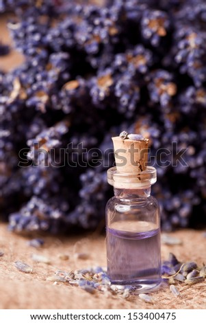 lavender flower with liquid homeopathic fragrance - stock photo