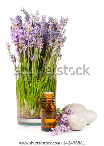 lavender flowers and essential oil isolated on white - stock photo