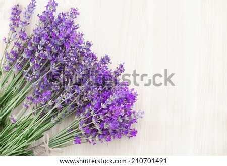 Lavender flowers on a wooden desk. - stock photo