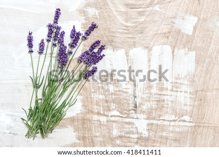 Lavender flowers on rustic wooden background. Fresh lavender blossoms. Lavender herb. Shabby chic - stock photo