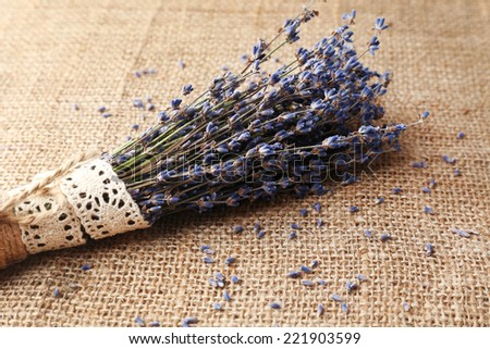Lavender flowers on sackcloth background - stock photo