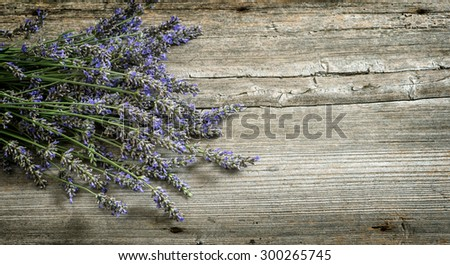 Lavender flowers on wooden background. Vintage style toned picture - stock photo