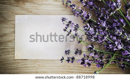 Lavender flowers over wooden background with blank - stock photo