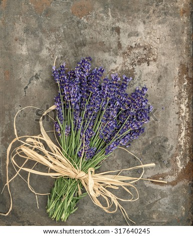 Lavender flowers with shabby chic style decorations. Fresh blossoms over rustic metal background - stock photo