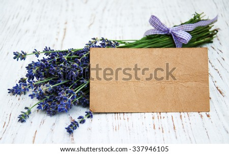 lavender flowers with tag on a old wooden background - stock photo