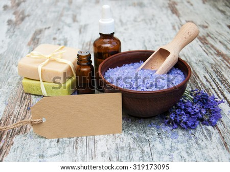 Lavender, handmade soap and  sea salt  on a wooden background - stock photo