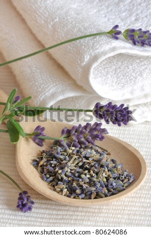 lavender herb on the wooden spoon with towels - stock photo