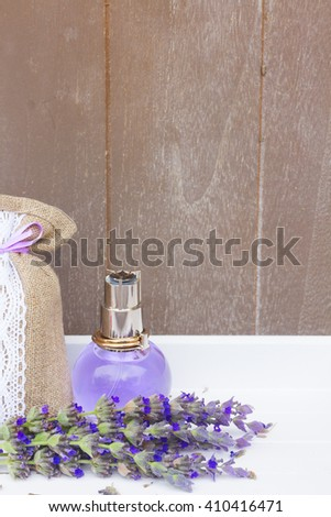 Lavender herbal aroma water, fresh flowers and dry in pouch - stock photo