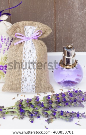 Lavender herbal water, fresh blue flowers and dry in pouch close up - stock photo
