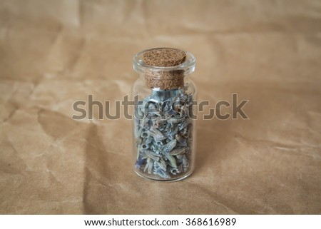Lavender in a bottle - stock photo