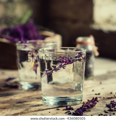 lavender lemonade in glasses on a wooden table.  - stock photo