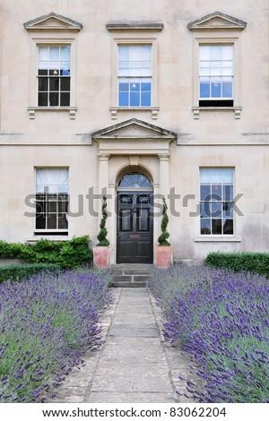 Lavender Lined Garden Bath Leading to a Beautiful Georgian Era London Town House - stock photo