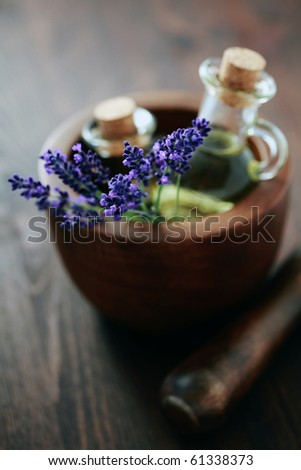 lavender massage oil with mortar and pestle - beauty treatment - stock photo