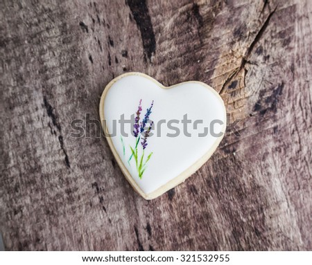 Lavender motive biscuit on a wooden background. Natural light - stock photo