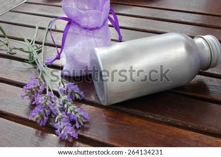 Lavender oil,flowers,bath salt on wooden background - stock photo
