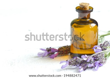Lavender oil on white planks closeup - stock photo
