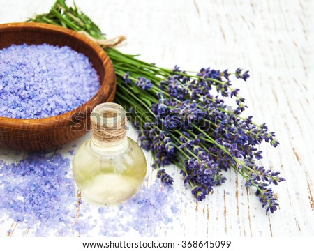 lavender oil with bath salt and fresh lavender on a old wooden background - stock photo