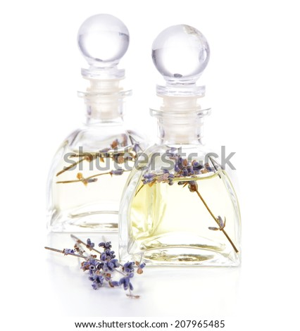 Lavender oil with flowers, isolated on white - stock photo
