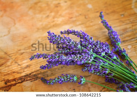 Lavender on old rustic wood - stock photo