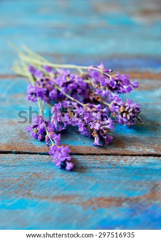 lavender on the blue rustic table - stock photo