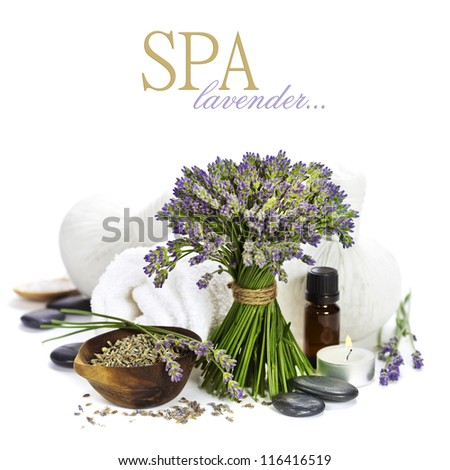 lavender spa (fresh lavender flowers, towel, essential oil, pebbles, Herbal massage balls) over white  (with easy removable text) - stock photo