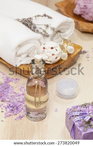 Lavender spa treatment. Various objects and beauty products on the wooden board. A macro photograph with  shallow depth of field.  - stock photo