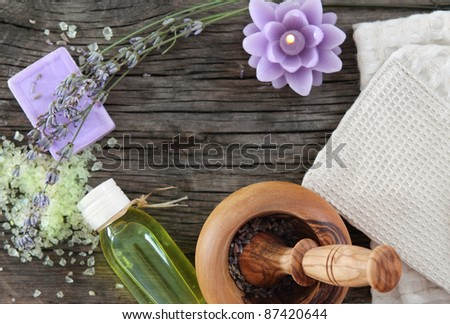 Lavender spa with essential oil over wooden background - stock photo