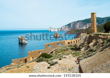Laveria Lamarmora, an old mine building along the coast of Nebida and Masua, west coast of Sardinia, Italy - stock photo