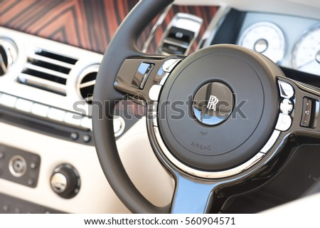 LAVERSTOKE, UK - AUGUST 25: Luxurious steering wheel and dashboard closeup from a Rolls Royce Ghost automobile at in Laverstoke, UK on August 25, 2016
