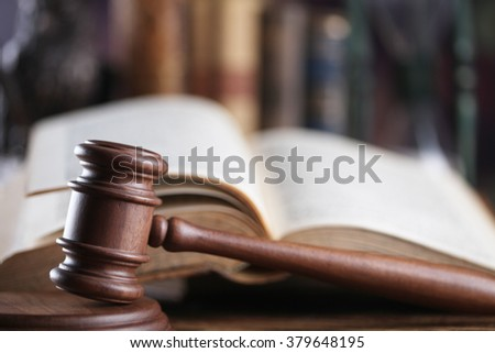 law and justice theme, mallet of a judge, books - stock photo