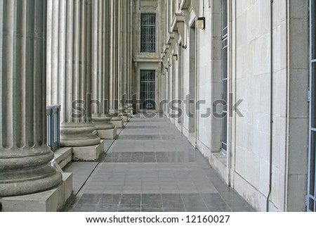 Law and Order Pillars in the Supreme Court during the day - stock photo