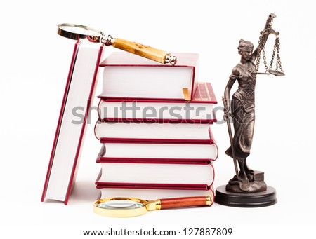 law book, magnifying glass and scales of justice - stock photo
