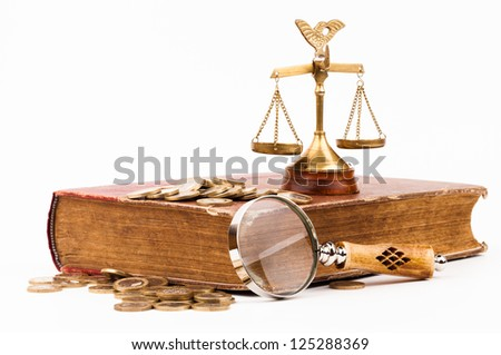 law books, money , magnifying glass and scales of justice - stock photo