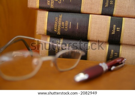 Law books stacked with glasses
