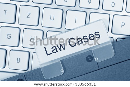Law Cases - folder with text on computer keyboard - stock photo