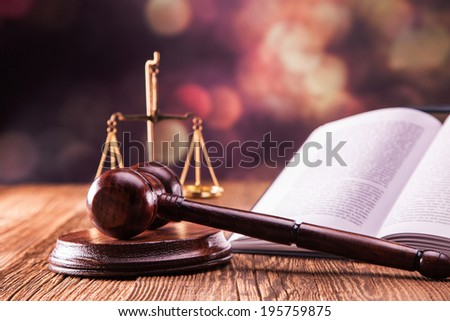 Law code, gavel and books. - stock photo