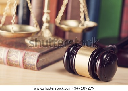 Law concept, gavel, scale and books - stock photo