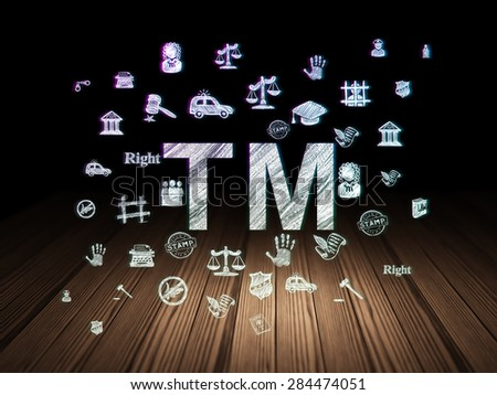 Law concept: Glowing Trademark icon in grunge dark room with Wooden Floor, black background with  Hand Drawn Law Icons, 3d render - stock photo