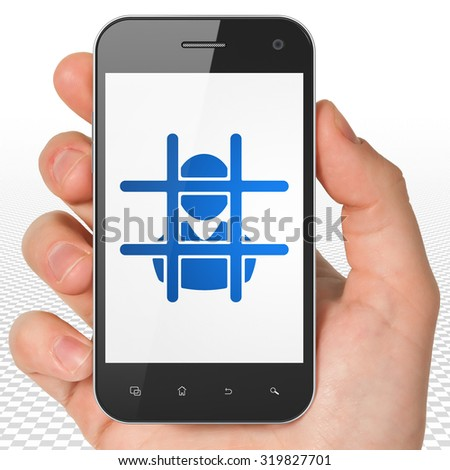 Law concept: Hand Holding Smartphone with blue Criminal icon on display - stock photo