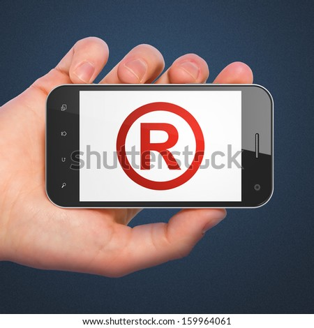 Law concept: hand holding smartphone with Registered on display. Mobile smart phone on Blue background, 3d render - stock photo