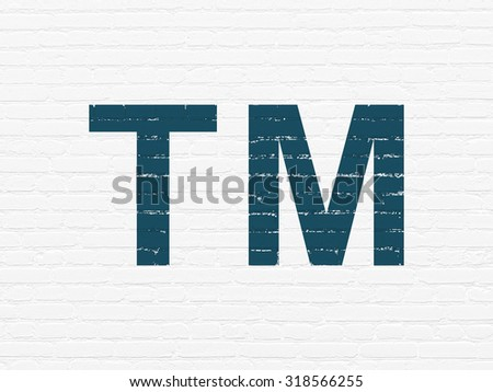 Law concept: Painted blue Trademark icon on White Brick wall background - stock photo