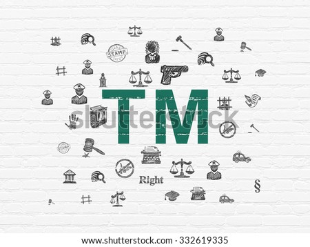 Law concept: Painted green Trademark icon on White Brick wall background with  Hand Drawn Law Icons - stock photo