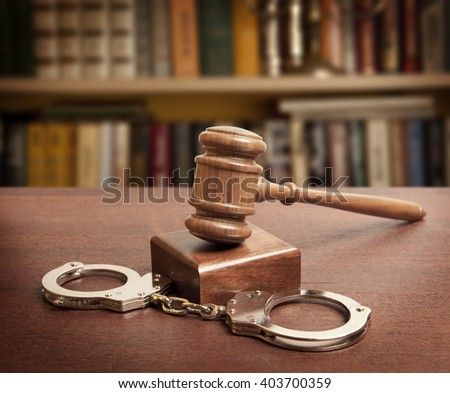Law concept photo - gavel and handcuffs - stock photo